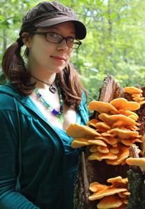 Emily Schmidt with orange & yellow sun fungus (Ryan Bouchard)